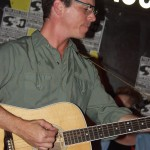 Paul Feltman on acoustic guitar
